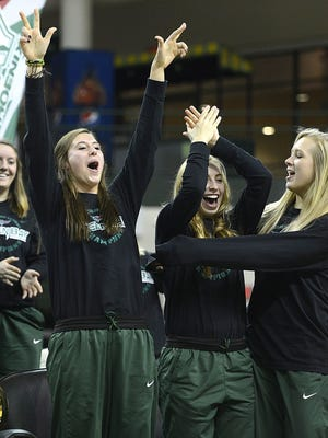 In middle, UW-Green Bay's Mehryn Kraker reacts with her teammates after the Phoenix were selected as the No. 9 seed in the Spokane Region of the NCAA tournament Monday night during a NCAA tournament selection show event at the Kress Events Center in Green Bay. The team will play eighth-seeded Princeton. Evan Siegle/Press-Gazette Media