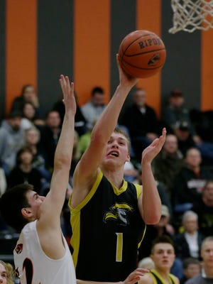 Waupun's Marcus Domask goes up for a shot over Ripon's Luke Rogers during their game.  Ripon Tigers hosted the Waupun Warriors  in boys basketball, Friday, January 12, 2018.