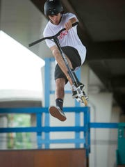 "Tommy Christiana, a 17-year-old senior at Alexis I. du Pont High School, does a trick at the Newport Skate Park on June 26. ""I used to play basketball and other sports like that but it was a little too organized. You can come here and just do whatever tricks you want,"" Christiana says."