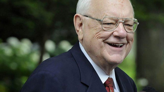 In this July 3, 2013, photo, former Illinois Gov. George Ryan speaks with reporters outside his home in Kankakee, Ill., after he was released from home confinement, ending more ending more than 5 1/2 years in federal custody for wide-ranging corruption offenses.