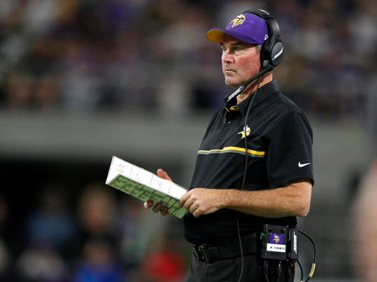 FILE - In this Sept. 18, 2016, file photo, Minnesota Vikings head coach Mike Zimmer stands on the sidelines during the first half of an NFL football game against the Green Bay Packers in Minneapolis. Aaron Rodgers expresses admiration and respect for Minnesota's defense under Mike Zimmer, one of the few coaches who've had some success in thwarting Green Bay's exceptional quarterback. But Zimmer has his own anxiety about preparing for and playing against Rodgers.  (AP Photo/Andy Clayton-King, File)