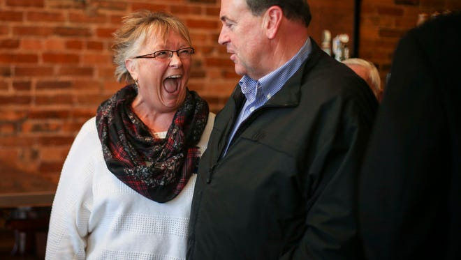 Vicki Adler of Albia laughs at a joke by Republican presidential hopeful former Arkansas governor Mike Huckabee during a campaign event Thursday Nov. 19, 2015, in Albia, Iowa.