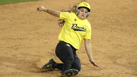 Oregon's Koral Costa slides to second as the Ducks fall to the UCLA Bruins 2-1 in Game 3 of the NCAA super regional on Sunday, May 29, 2016, at Jane Sanders Stadium in Eugene.