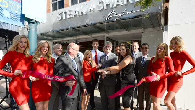 Maxim magazine girls joined Steak 'n Shake executives at the ribbon-cutting for the chain's first Los Angeles-area outlet. It began serving up steakburgers last week in Santa Monica, Calif.