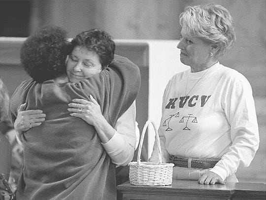 Barbara Ross, left, of Bellevue, with her back to the