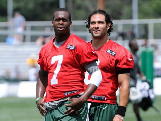 Jets quarterbacks Geno Smith (7) and Mark Sanchez at