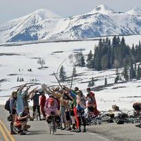 Cyclists gather on Swan Lake Flats after pedaling up from Mammoth, Wyo., to cheer on fellow bikers.