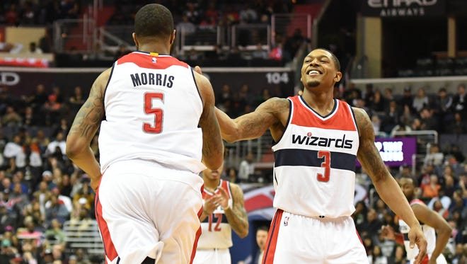 Washington Wizards guard Bradley Beal (3) reacts after  forward Markieff Morris (5) basket during the fourth quarter against the New York Knicks at Verizon Center.