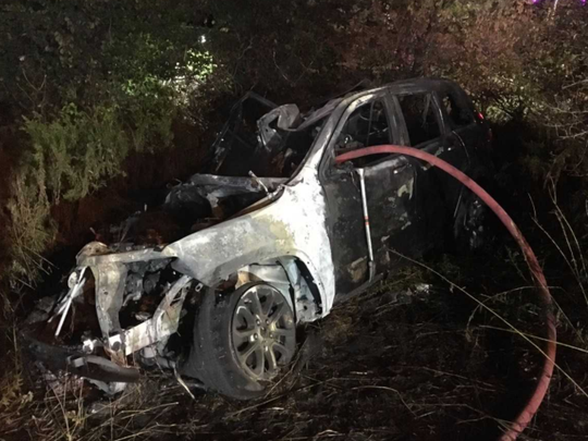 A 27-year-old woman was pulled from the passenger side of a burning Jeep Grand Cherokee in a dramatic rescue by New Berlin and Greenfield police officers and citizens.