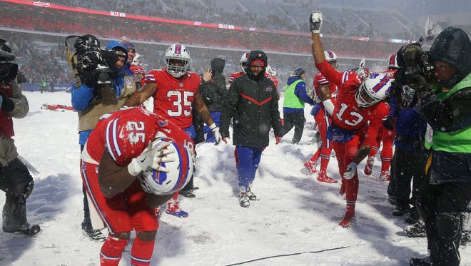 Bills running back LeSean McCoy is pelted with snowballs by Kelvin Benjamin after scoring the game winning touchdown on a 21-yard run in overtime to beat the Colts 13-7.