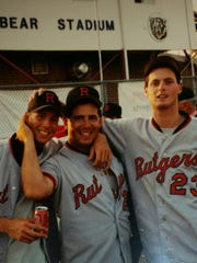 Doug Alongi, right, with Rutgers University baseball teammates Scott Simpson, left, and Mike Winchock, following a 1993 Atlantic 10 Conference Tournament victory.