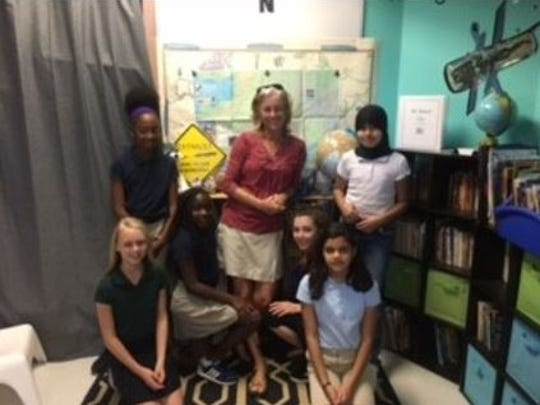 Kim Slade with some of her 5th-grade students at Glendale Elementary.