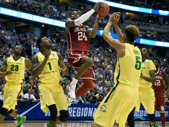 Oklahoma Sooners guard Buddy Hield (24) moves in to