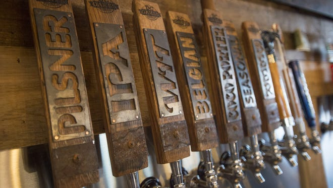 Tap handles line the bar at DC Oakes Brewhouse and Eatery, located on E. Harmony Road, on Thursday, May 4, 2017. The brewpub is one of the newest to join the Fort Collins restaurant scene that brought in over $100 million in sales for the first three months of 2017.
