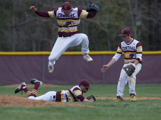 Central Regional pitcher Joe Bassett makes a diving