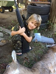 Hunting near Brooklyn, Miss., with his mother, Angie