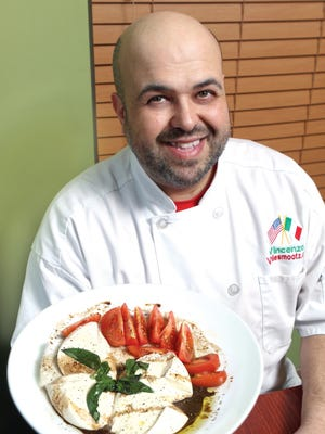 "Vincent ""Mootz"" Morelli poses with his famous mozzarella with tomatoes in Lyndhurst, Monday, March 12, 2018."