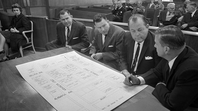 FILE - In a Dec. 9, 1965 file photo, three defendants go over a street diagram of area in Selma, where the clubbing death of a Unitarian Universalist minister Rev. James Reeb took place last March during civil rights strife. From left: Stanley and Namon Hoggle, brothers, and Elmer Cook, all defendants, and Robert Radford, investigator.  An obituary says Namon Hoggle, the last of three men acquitted in the infamous civil rights slaying, died Tuesday. He was 81.