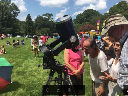 Jeffrey Scott of Olive Branch peers through a telescope