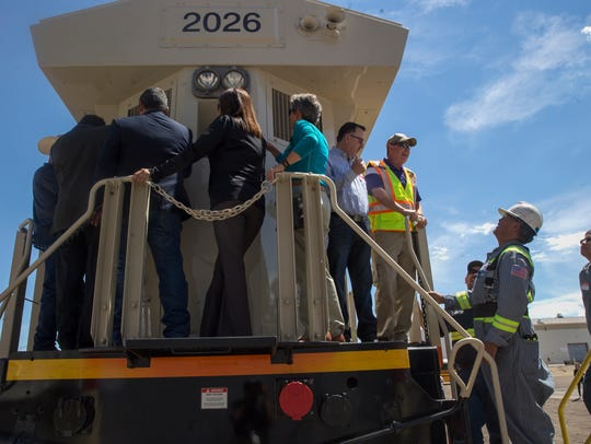 Dignitaries tour one of the new locomotives  Wednesday