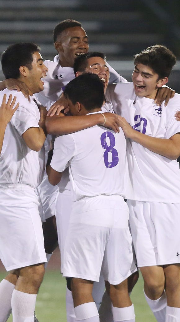 New Rochelle's Oscar Espinoza (13) celebrates with