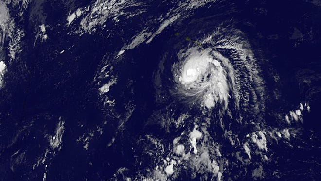 Tropical Storm Ana spins Oct. 18, 2014, at 2:00 a.m. EDT. The National Weather Service said Friday that Ana became a Category 1 hurricane about 230 miles south of Hilo, with maximum sustained winds of 80 mph.