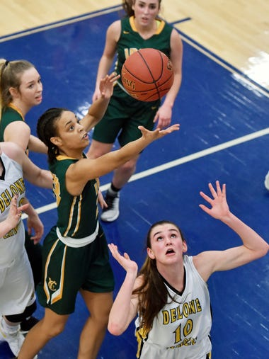 York Catholic's Jania Wright fights for the rebound