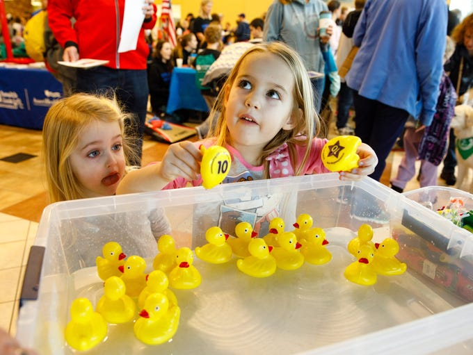 Brielle Sheckels, 5, (right) picks out ducks while
