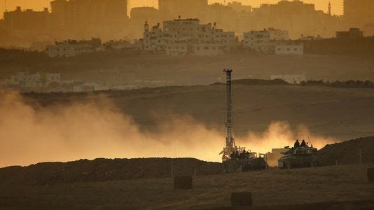 Israeli soldiers use heavy equipment to dig down and destroy the Hamas tunnels at the Israeli-Gaza border on Aug. 3.