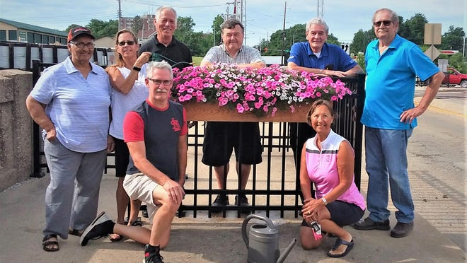 Galesburg Rotary Club Sunrise, Galesburg Lumber & Construction Supply, the Garden Station, and retired firefighters have collaborated with the City of Galesburg to build, plant, hang and maintain petunia boxes on the pedestrian mazes near the at-grade crossings on Academy, Broad and Prairie streets. Pictured in the back row, from left: Louise Wilder, Marcia Bullis, Scott Warren, Marty Reichel, Harrel Timmons and Dave Marshall. Front row: Tom Simkins and Mary Burgland.