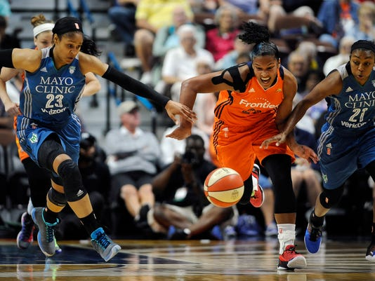 Minnesota Lynx' Maya Moore, left, and Renee Montgomery, right, pursue Connecticut Sun's Alyssa Thomas during the first half of a WNBA basketball game, Thursday, July 7, 2016, in Uncasville, Conn. (AP Photo/Jessica Hill)