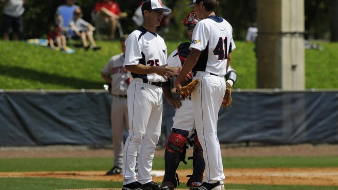 FAU pitching coach Jason Jackson (left) makes a mound visit to talk to his pitcher during the 2012 season.