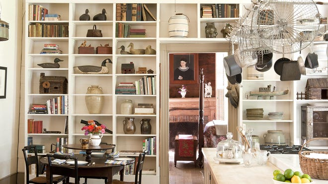 """This is one of the rooms in an 1850s Alabama farmhouse featured in the book """"Past Present: Living With Heirlooms and Antiques,"""" by Susan Sully."""