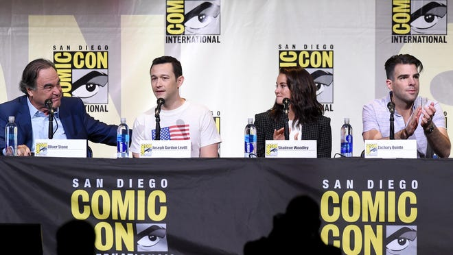 "Writer/director Oliver Stone, left, actors Joseph Gordon-Levitt, Shailene Woodley, and Zachary Quinto attend the ""Snowden"" panel Thursday during Comic-Con International 2016 at San Diego Convention Center."