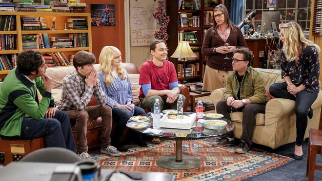 """This image released by CBS shows Kunal Nayyar, from left, Simon Helberg, Melissa Rauch, Jim Parsons, Mayim Bialik, Johnny Galecki and Kaley Cuoco appear in a scene from the long-running comedy series """"The Big Bang Theory."""" The popular series will end in 2019."""