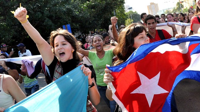 Cuban students march in a street of Havana, on December 17, 2014, after Washington released three Cuban spies -- heroes in Cuba-- who had been in a US prison since 2001. The United States and Cuba brought their bitter Cold War stand-off towards a historic close Wednesday, agreeing to revive diplomatic ties and to ease a five-decade US trade embargo.