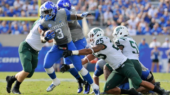 UK's Jojo Kemp breaks away from the Ohio defense in the second half, Saturday, Sept. 06, 2014, at Commonwealth Stadium in Lexington.