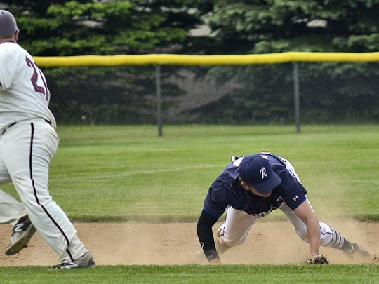 A sharply-hit ground ball squirts away from Richmond's