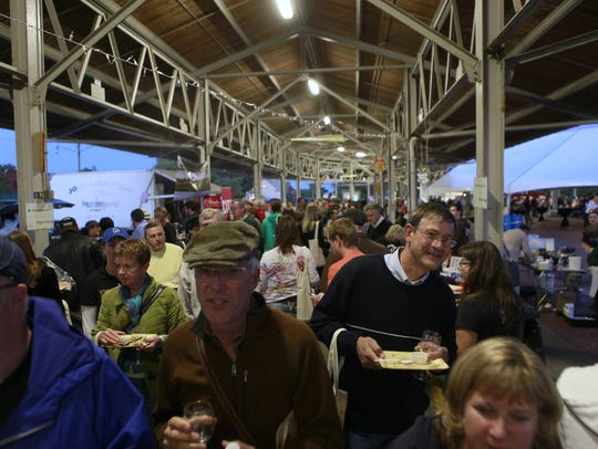 Crowds move through the Public Market during the Festival