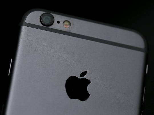 The Apple logo is displayed on an iPhone 6 on July