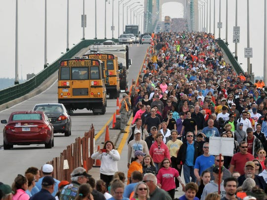 Pictured: Walkers cross the Mackinac Bridge during the 2014 Labor Day bridge walk. This walk runs on Sept. 5 this year.