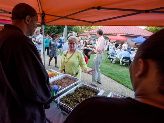 Martha's Place serves up food as locals take part in the food and spirits at the 'Zoobilation: Welcome to Stingray Bay' fundraiser at the Montgomery Zoo in Montgomery, Ala. on Thursday September 15, 2016.