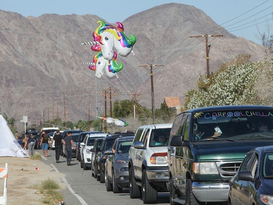 A long line of people wait to get into the Coachella