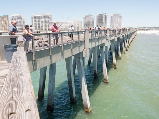 People fish off the pier in Navarre Beach on Thursday, May 25, 2017. At the request of some residents, the Santa Rosa County Board of Commissioners are looking to install a mobile restroom facility on the pier.