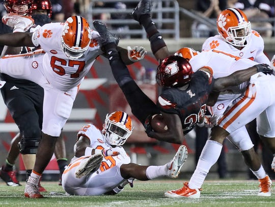 Louisville's Malik Williams runs into the Clemson defense