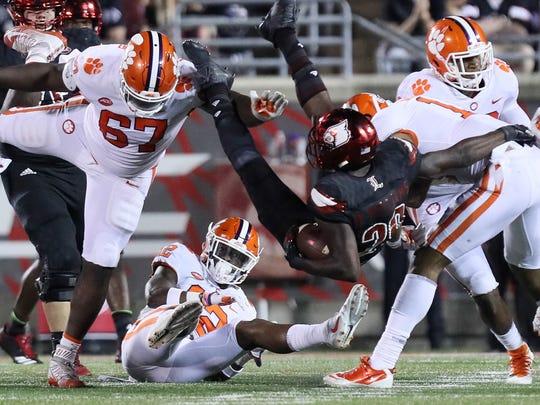 Louisville's Malik Williams runs into the Clemson defense