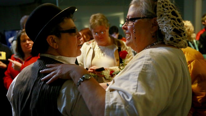 Beth and Lisa Bashert of Ypsilanti embrace before getting married at the Washtenaw County Clerk's Office in Ann Arbor on March 22.