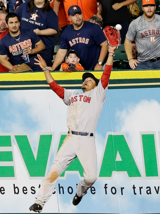 Boston Red Sox right fielder Mookie Betts can't get his glove on the ball giving Houston Astros' Carlos Correa a double in the ninth inning of a baseball game Sunday, April 24, 2016, in Houston. (AP Photo/Pat Sullivan)
