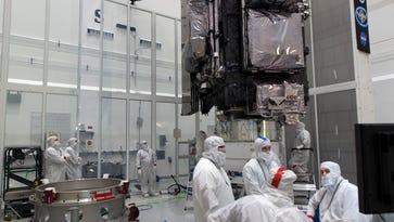 Weather satellite lifted atop Atlas V rocket for March 1 launch from Cape Canaveral