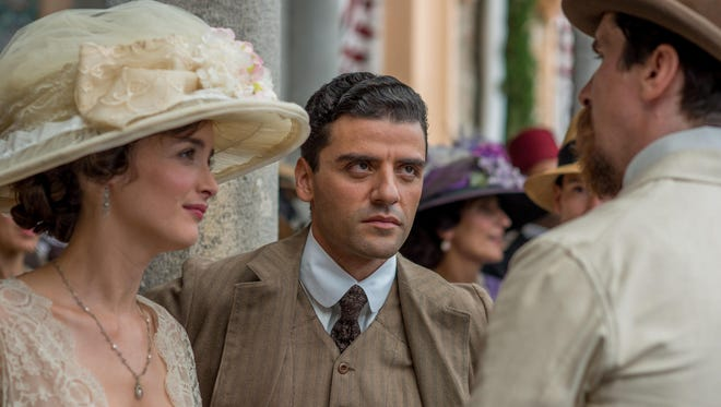 """""""The Promise"""" is a love triangle between (from left) Charlotte Le Bon, Oscar Isaac and Christian Bale."""